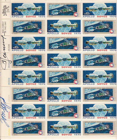 ASTP COMMANDER SIGNED STAMP SHEET. A full sheet of 10 cent Apollo Soyuz stamps, 10 x 9 inches, featuring two different artist renderings of the space vehicles in earth orbit.