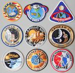 LION BROTHERS CREW MISSION EMBLEMS. Cloth crew mission emblems, 18 total with sizes from 3½ to 5 inches in diameter.