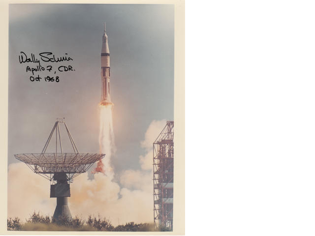 SCHIRRA'S APOLLO 7 LAUNCH PHOTO—SIGNED. Color photograph, 10 x 8 inches, with printed NASA captions on verso.