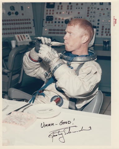 ASTRONAUT MEAL TIME. Color photograph, 10 x 8 inches, with a red NASA ID number at the upper border.
