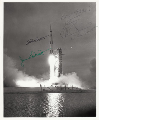 SECOND MANNED SATURN V LAUNCH. Black and white photograph, 10 x 8 inches, with NASA printed text on verso.