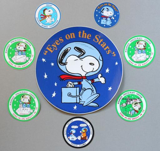 "SNOOPY—MANNED FLIGHT AWARENESS COLLECTION. INCLUDING LARGE ""EYES ON THE STARS"" DECAL.  A collection of eight period decals ranging from 3 to 10 inches in size."