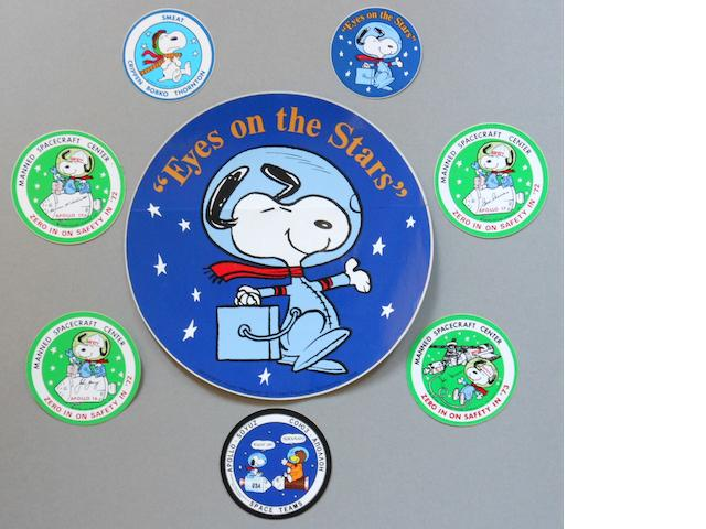 "SNOOPY—MANNED FLIGHT AWARENESS COLLECTION.  INCLUDING LARGE ""EYES ON THE STARS"" DECAL.<BR /> A collection of eight period decals ranging from 3 to 10 inches in size."