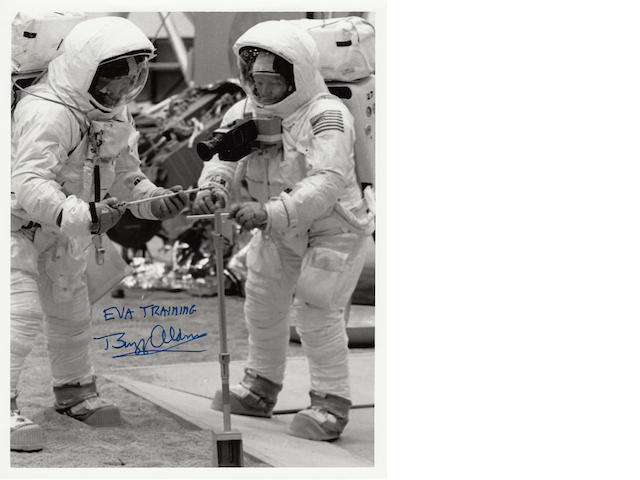ARMSTRONG AND ALDRIN TRAIN FOR LUNAR TASKS. Black and white photograph, 10 x 8 inches, with NASA text printed on verso.