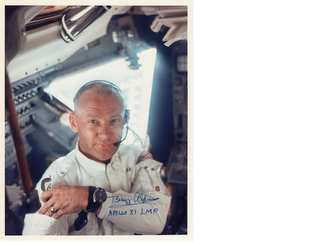 ARMSTRONG SNAPS ALDRIN INSIDE THE LUNAR MODULE. Color photograph, 10 x 8 inches.