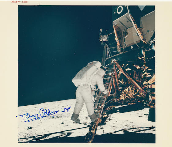 ALDRIN DESCENDS TO THE LUNAR SURFACE. Color photograph, 8 x 10 inches with NASA identification number at upper border.