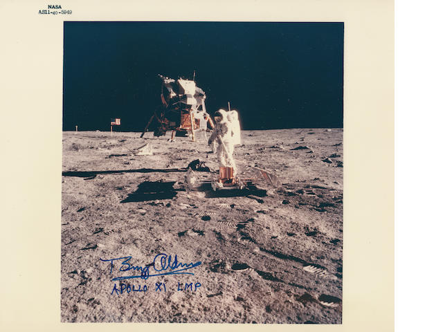 ALDRIN SETS UP EXPERIMENTS ON THE MOON. Color photograph, 8 x 10 inches with NASA identification number at upper border.