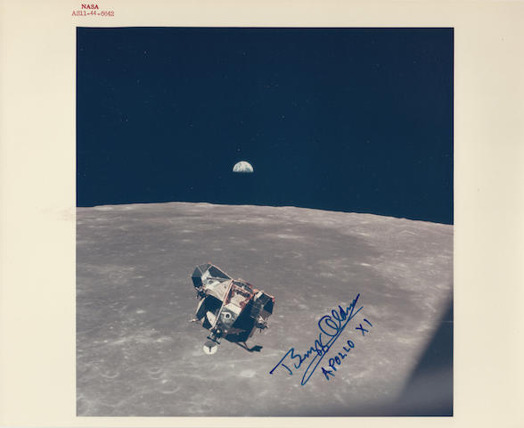 EAGLE'S RETURN TO LUNAR ORBIT. Color photograph, 8 x 10 inches with NASA identification number at upper border.