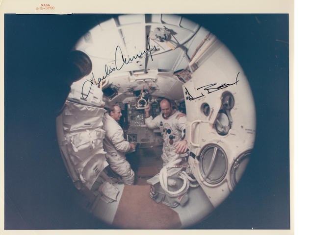 INSIDE THE LUNAR MODULE TRAINER AT KSC. Color photograph, 8 x 10 inches, with NASA identification number at upper border.
