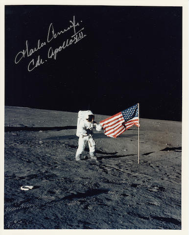 CONRAD RAISES OLD GLORY ON THE MOON. Color photograph, 10 x 8 inches.