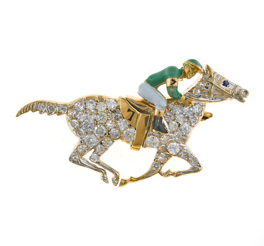 A diamond and enamel jockey brooch with sapphire eye
