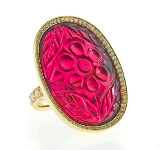 A carved pink tourmaline and diamond ring