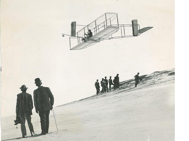 ORVILLE AND THE 1911 GLIDER AT KILL DEVIL HILLS. Group of 11 black and white photographs, 5½ x 7 inches and slightly smaller, most with inkstamped credit on verso of the P-J Press Bureau of Philadelphia.
