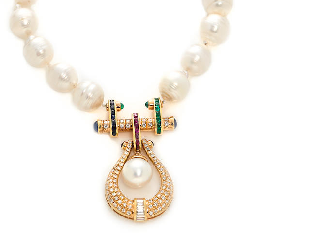 A semi-baroque cultured pearl, ruby, sapphire, emerald and diamond necklace