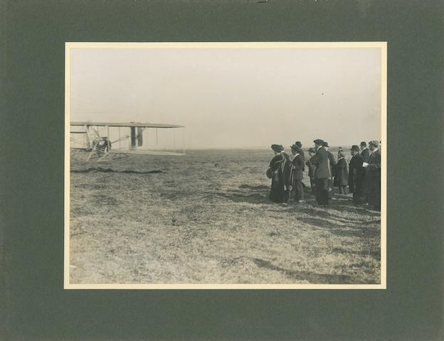 PAU 1909: A MAN AND HIS FLYING MACHINE. Black and white photograph, 7 x 9½ inches, mounted.