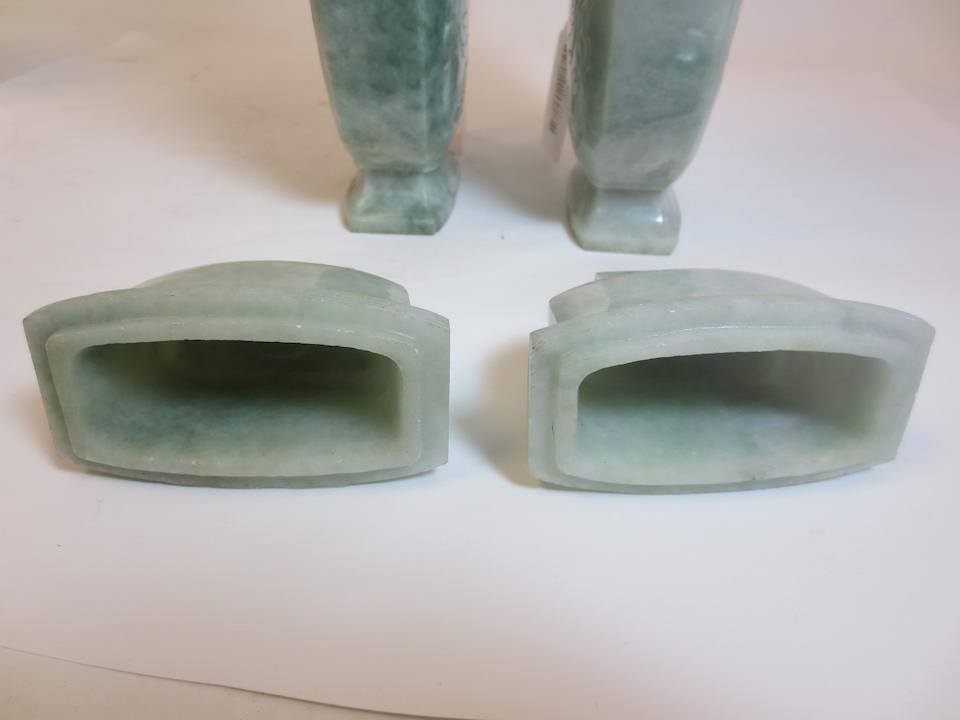 A pair of jadeite covered vases