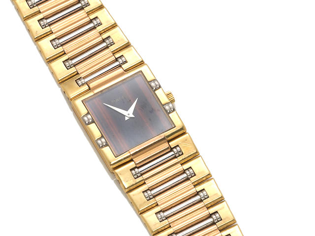 A tiger's eye and eighteen karat tricolor gold integral bracelet wristwatch, Piaget