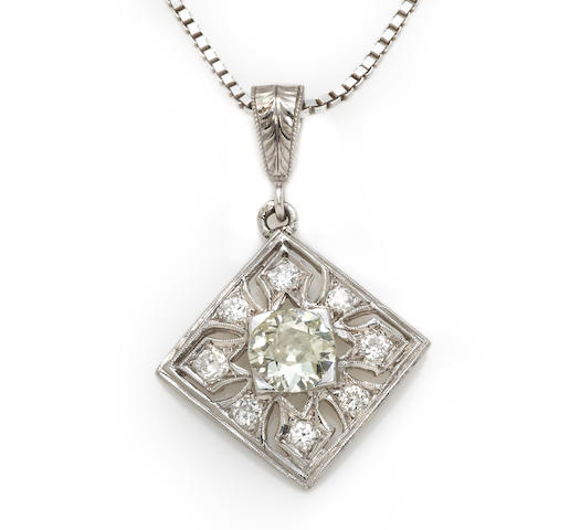 A colored diamond and diamond pendant with silver chain