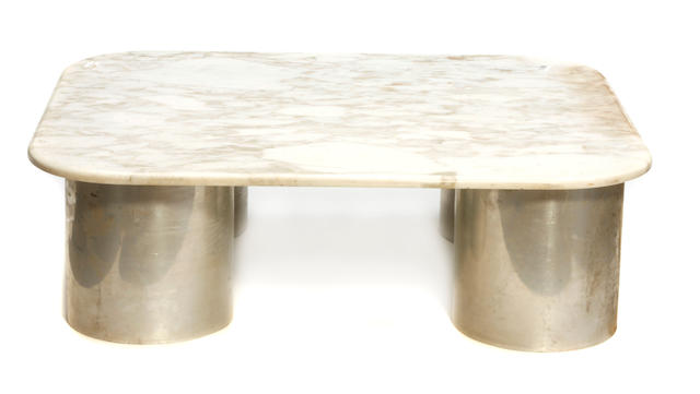 An Italian aluminum table with marble top circa 1980