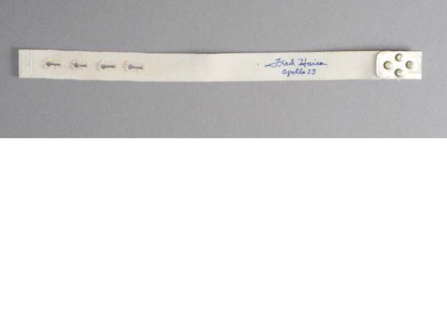 FLOWN FILM EQUIPMENT STOWAGE STRAP—SIGNED. Flown A8 (AFT 8) Command Module equipment locker stowage strap.