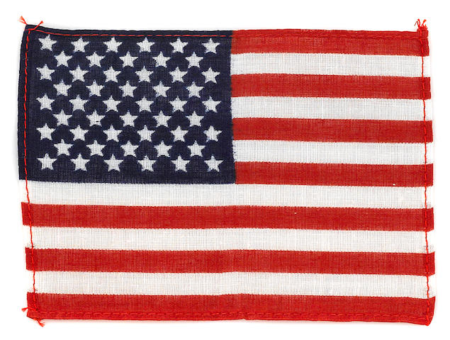 SCOTT'S US FLAG CARRIED ON MULTIPLE MISSIONS. Flown US flag, linen, 4 x 5½ inches.
