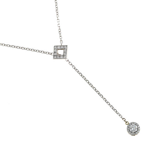 A diamond lariat necklace
