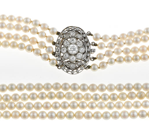 A cultured pearl and diamond four-strand necklace