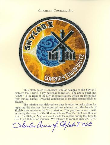 28 DAYS IN ORBIT—CONRAD'S SKYLAB I EMBLEM. LETTER GIVING DETAILS ON A RECORD BREAKING FLIGHT.  Flown Skylab I cloth emblem, 4 inches in diameter.