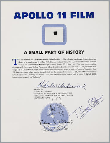 FLOWN APOLLO 11 HASSELBLAD FILM SEGMENT—SIGNED. A ¼ by ¼ inch segment of 70mm Hasselblad camera film displayed on an 11 x 8 ½ inch certificate.