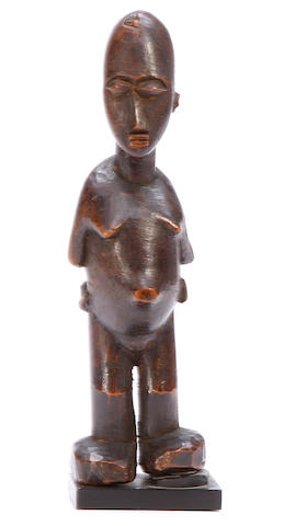 A standing maternity figure