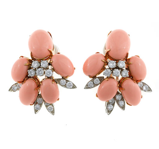 A pair of coral cabochon and diamond earclips