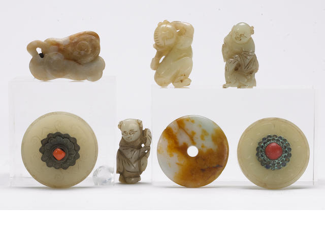 A group of seven jade and hardstone decorations