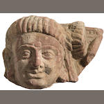 A red mottled sandstone head of a devotee Northern India, Kushan period, circa 2nd century