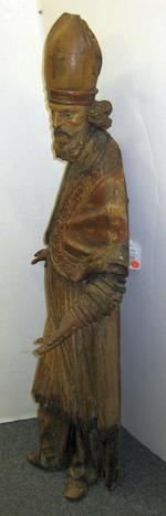 A Spanish Baroque polychrome and gilt decorated carved wood figure of a bishop <BR />17th century