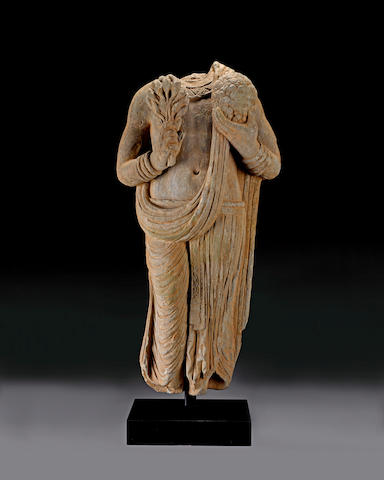 A green schist torso of a donor Ancient Region of Gandhara, Taxila region, circa 2nd century