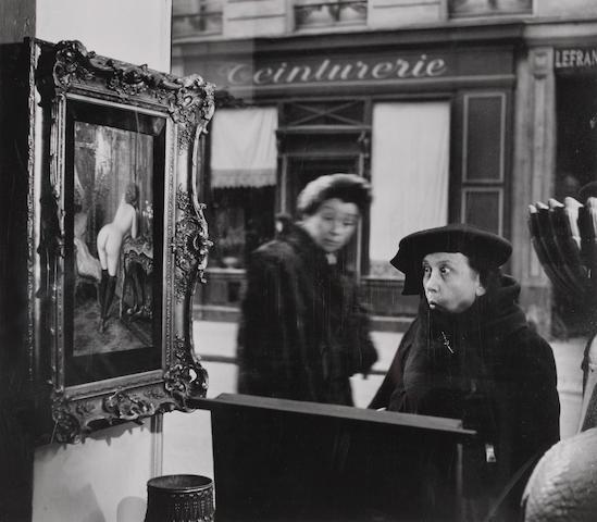 Robert Doisneau (French, 1912-1994); La dame indignée, vitrine Galerie Romi, Paris;