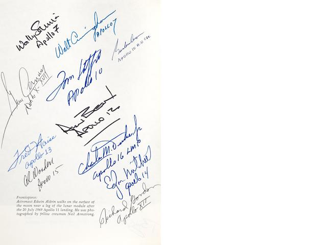 THE HISTORY OF MANNED APOLLO LUNAR SPACECRAFT. SIGNED BY TWELVE APOLLO ASTRONAUTS.<BR />