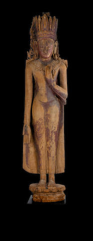A standing crowned wooden Buddha, Burma, Pagan period, 13th/14th century