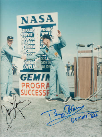ALDRIN AND LOVELL CELEBRATE GEMINI SUCCESS. Color photograph, 10 x 8 inches.