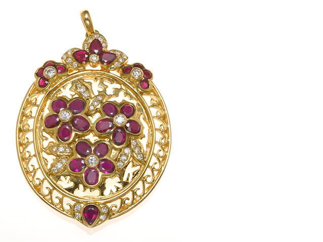 A ruby, diamond and 18k gold flower motif pendant