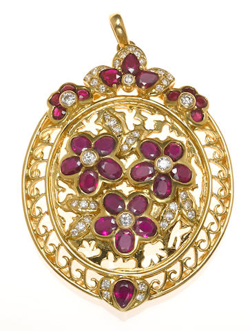 A ruby, diamond and 18k gold flower motif pendant