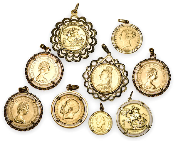 A collection of nine assorted gold coin, 18k and 9k gold pendants