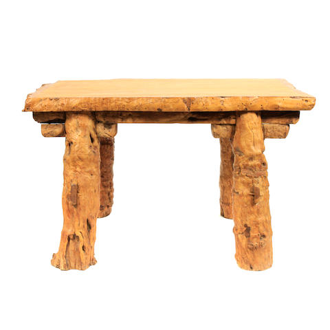 A large rustic gnarled wood table
