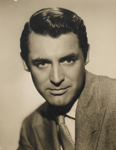 A SCOTTY WELBOURNE PHOTOGRAPH OF CARY GRANT.