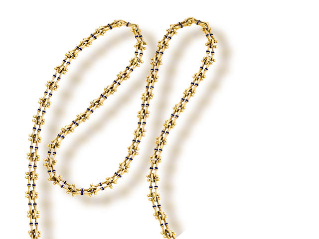An eighteen karat gold and enamel chain
