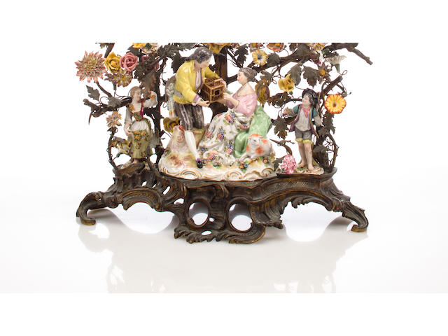 A Rococo style gilt metal and porcelain figural mantel clock second quarter 19th century