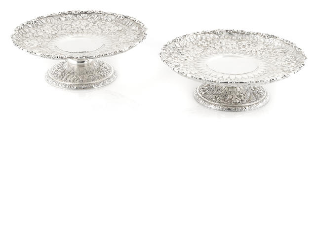 A near pair of American  sterling silver  floral and foliate-repousse-decorated compotes  by Tiffany & Co. New York, NY, 1907-1947