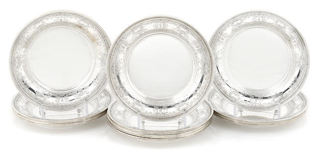 A set of ten International Sterling bread plates