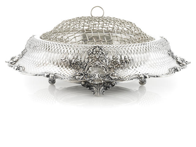 An American sterling silver pierced centerbowl, with flower frog