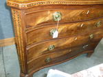 A pair of George III style inlaid mahogany chests of drawers<BR />partially incorporating antique elements